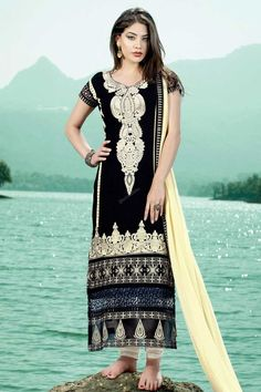 Black georgette, semi stictch churidar suit. Daman/hem and neck embroidered with embroidered and zari work. Round neck, Below knee length, short sleeves kameez. White santoon churidar. Cream chiffon dupatta with lace border with work. http://www.andaazfashion.com/salwar-kameez/churidar-suits/view/new-arrival-churidar-suits