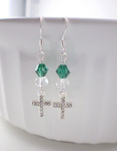 These sweet, beautiful Christian earrings are made of teal-colored swarovski bicone beads, crystal-colored glass beads, and crystal cross charms. These earrings sparkle in the light. The earrings come in a pretty organza bag making it ready for gift-giving.  LENGTH: 1 & 3/4 inches total (ear wire to end of charm)