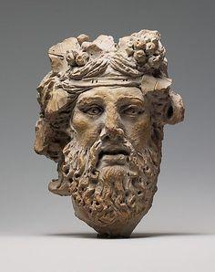 Cabeza de terracota de Dionisio (siglo primero antes de Cristo), el griego .: