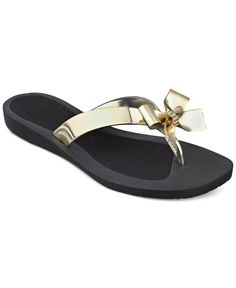 Guess dresses up the classic flip flop with a decorative bow for a sweet touch. | Imported | Rubber upper | Bow detail on strap | Man-made sole | Web ID:2453436