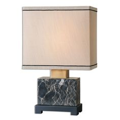 Add a touch of light and beauty with this marble based table lamp. This lamp is accented with a brass plated neck and a satin black foot. This lamp is completed with a rectangle hardback beige linen fabric shade