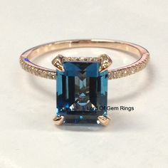 Topaz Diamond Engagement Ring,Emerald Cut 8x10mm London Blue Topaz 14K Rose Gold Diamonds Weddding Promise Bridal Ring,Claw Prongs by TheLOGR on Etsy https://www.etsy.com/listing/218818395/topaz-diamond-engagement-ringemerald-cut