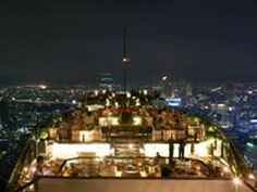 Vertigo Grill & Moon Bar another romantic rooftop restaurant in Bangkok. The restaurant is located on the rooftop of Banyan Tree Hotel, also in the city center area. Vertigo is the place that you can amuse in a luscious seafood grill and first-class steaks prepared by our chefs whereas you get pleasure from the magnificent and panoramic views of the city.    Open daily (weather permitting)   Vertigo: 6:00pm to 11:00pm. Booking required.   Moon Bar: 5:00pm to 1:00am