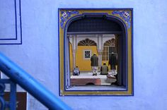 Jaipur, India: Men offer prayers at Diggi Palace during the Jaipur literature festival