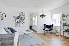 Black-n-white decorating ideas in Scandinavian style can turn small rooms into spacious living spaces and create beautiful and modern interior design with a touch of other accent color. Lushome presents white and black apartment ideas, spiced up with green house plants which create natural and pleas