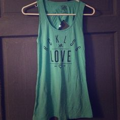 Teal reckless tank Teal reckless tank top with super cute back display Reckless Tops Tank Tops