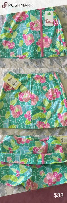 NWT Lilly Pulitzer Skort girls 12 NEW Brand new, with tags Lilly Pulitzer skort (skirt with built in shorts). Signature boutique Lilly fabric. *this is from a boutique, not target** girls size 12 Lilly Pulitzer Bottoms Skorts