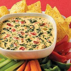 Kick off your next party or Thanksgiving dinner with our Cheesy Spinach and Bacon Dip! Chilies bring the heat to this delicious spinach and bacon dip. Dip Recipes, Appetizer Recipes, Great Recipes, Snack Recipes, Cooking Recipes, Favorite Recipes, Cooking Tips, Dip Appetizers, Delicious Appetizers