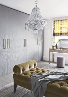 An inventive way to soften a wall of wardrobe doors in a dressing room is to cover them with a pretty wallpaper. Homes & Gardens. Styling Marisa Daly, photographs Jan Baldwin.  http://www.hglivingbeautifully.com/2016/02/18/design-ideas-for-cosy-bedrooms/