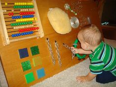 Play At Home Mom LLC: Toys for Months including the home made sensory board Baby Sensory Board, Sensory Wall, Sensory Rooms, Autism Sensory, Sensory Boards, Sensory Activities, Infant Activities, Activities For Kids, Infant Classroom