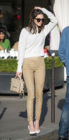 Kylie Jenner wearing Grey Cropped Sweater, Tan Skinny Pants, White Leather Pumps, Tan Leather Satchel Bag