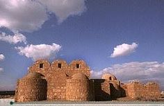 Qusayr 'Amra, Jordan, is about 28 kilometers from Azraq. This is the best preserved of the desert castles, and probably the most charming