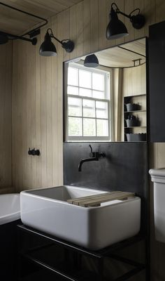 Bathroom with Canadian maple wood paneling.