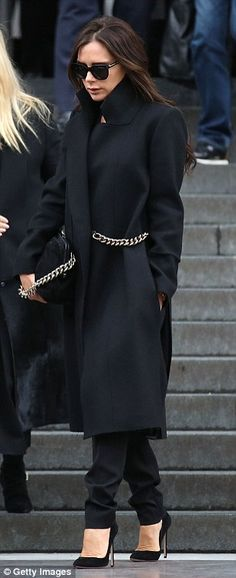 Keeping warm: The mid-February chill didn't stand a chance against Victoria's cosy coat with its high collar and warming pockets