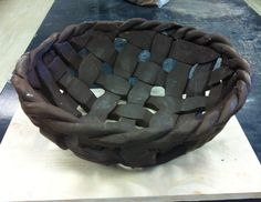 Large woven ceramic bowl.
