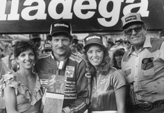 Dale pictured with wife, Teresa, Miss Winston, and his car owner at the time, Bud Moore.  This was Dale's Ford years.  #DaleEarnhardtMemorial http://www.pinterest.com/jr88rules/dale-earnhardt-memorial/