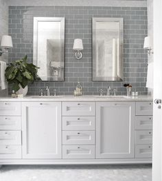 "Bathroom Wall Tile and Floor Tile. Wall tile is 3x6"" Grey glass tiles. The flooring is a Carrara Hexagon Tile. #Walltile #3x6 #Grey…"
