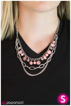 Hopelessly Devoted To You.  Pink beads swirled with white combine with solid pink beads and silver accents along a classic silver chain. A thicker silver chain with oversized links and two additional strands of silver are layered below, creating the illusion of multiple necklaces. Features an adjustable clasp closure.  Includes a pair of matching earrings!