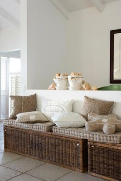 Love the rattan trunks under the seating area for extra storage, and adds nice natural texture to the room..