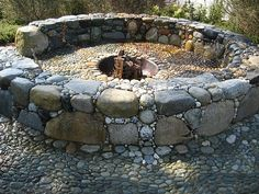 This is the fire pit idea that I like. Put some seating in so you arn't just sitting on cold stone and you there have it!