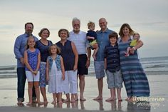 Large family beach photo with blue/white/yellow