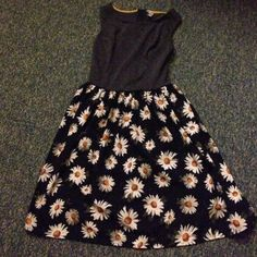 Sunflower dress Super cute sunflower dress only worn twice. Has a double skirt with a black one underneath for coverage.  Grey bodice. Xhilaration Dresses