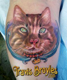 Portrait of her cat, Cheddar.     Tattoo by:Travis Broyles  http://travisbroyles.com