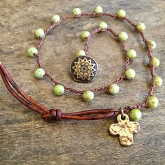 Beautiful green Czech beads are crocheted onto dark brown nylon cord accenting the amazing color of these gorgeous beads. An artisan bronze