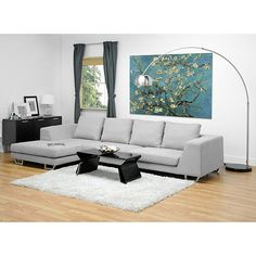 Add modern styling to your home with this contemporary large sectional sofa. This sofa features a 3.5 seater design plus a chaise. It is made with high density foam and a sturdy hardwood frame. The upholstery has a stone grey finish.