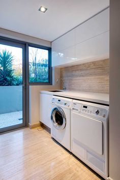 This laundry room has access to the outdoors, and includes as much storage as possible, but also leaves room for a nice counter for folding clothes.