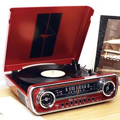 Buy ION Audio Mustang LP - Vinyl Record Player / Turntable with Built In Speakers, Plus a Radio, USB Playback and Aux Input - Vibrant Red Finish. Top Tech Gifts, Tech Gifts For Men, Electronic Gifts For Men, Crosley Record Player, Retro Record Player, Record Players, Radios, Ford Mustang, Antique Radio