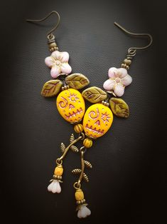 100 % Artisan Made; wire wrapped flowers and leaves atop zombie style sugar skulls with a flower pod and branch drop below, finished off with brass ear wires. Wire Earrings, Earrings Handmade, Drop Earrings, Handmade Jewelry, Zombie Style, Beads And Wire, Holiday Festival, Wire Wrapping, Hippie Boho