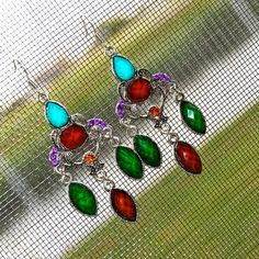 Stunning Chandelier Stone Crystal Earrings A striking mix of Forest Dark Green, Turquoise, Ruby Red, Fall Brown and add a topaz and purple crystal and you create these gorgeous chandelier earrings in vintage antique silver. Earrings are finished with a sterling silver French hook. Earrings measure 2 1/4 inches. KSAR Jewels Jewelry Earrings