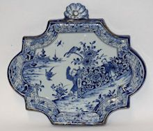 Dutch Delft blue and white plaque, 18th century, with two oriental figures against a floral fence. Offered by Guest & Gray at Grays.