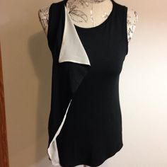 Ann Taylor Black Top MP Cute top with black/off white ruffle down front on one side. Ann Taylor Tops