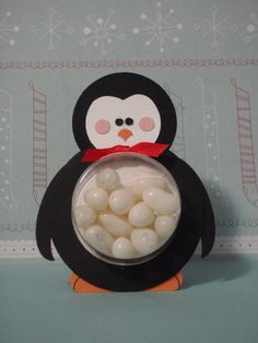 Christmas penquin with round pouch full of candy or ...