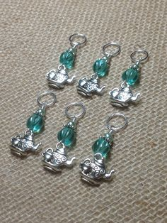 Eye catching teapot stitch markers that dangle between your stitches, a refreshing new way to work with your yarn. You'll look like a knitting rock star at the next group meeting or class. - Each set