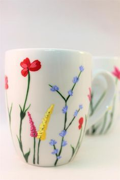 Wild flower coffee mugs, hand painted mugs with wild flowers, set of 2 Hand painted wild flower coffee mugs I took my popular wild flower design and threw it on some crisp white mugs! There are wistful wild flowers flowing in the breeze on the Painted Coffee Mugs, Hand Painted Mugs, Hand Painted Ceramics, Painted Pots, Hand Painted Pottery, Ceramic Cafe, Ceramic Mugs, Starbucks Ceramic Mug, Ceramic Bowls