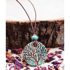 Wise Creations Blue & Brown Tree Circle Aromatherapy Pendant Necklace ($20) ❤ liked on Polyvore featuring jewelry, necklaces, circle necklace, leather necklace, circle pendant, blue necklace and leather pendant