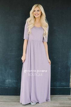 This soft and beautiful maxi dress will make you feel like you are wearing your pj's around but you will look absolutely amazing! A beautiful dusty lilac color, this maxi features a lined bodice, round neckline half sleeves and elastic waist.