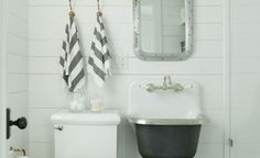 small basic cottage/farmhouse bathroom saves space with wall-mounted (painted) utility sink & faucet / Jenny Wolf , via Remodelista