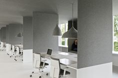 Tribal DDB office in Amsterdam by i29 Interior Architects. Through their design process they identified the needed material that could provide an alternative to traditional ceiling systems, as well as a focus on improving acoustics within an open plan office. This led them to fabrics, which led them to felt:  durable, acoustic, fire resistant properties. I love the felt lightshades