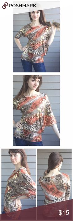 Cute Floral&Animal Print Blouse Wild top for a wild lady! Add this gem to your wardrobe to spice it up! Gold floral pattern over an animal print design. Top is in like new condition, no defects. Bundle to save 20% on you're order! Tops Blouses