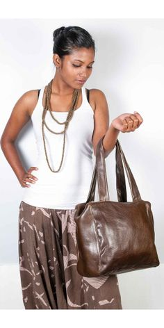 ark Brown Leather.... $73.00 USD  A Messenger Bag in Shrunken Vegetable Leather in Black Colour... $69.00 USD
