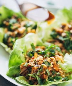 Peanut Chicken Lettuce Wraps Recipe: These wraps by Pinch of Yum are so delectably tangy that we dare you to stop eating after two of them (the best part is you don't have to be shy about eating more than two because they're pretty darn healthy). Start by marinating the chicken and peanuts (but not for long). Then brown the chicken, peanuts and rice noodles. Wrap with lettuce, drizzle a bit more sauce and enjoy.