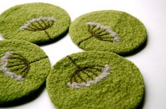 Queen Anne's Lace felted wool coasters from etsy seller shmugusta