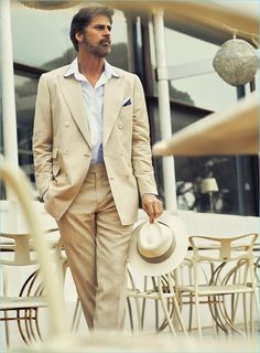 Model Mark Vanderloo embraces neutrals, wearing a double-breasted Massimo Dutti suit with a Panama hat by Harmont & Blaine.