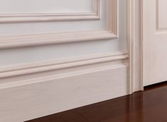 """Metrie French Curves Finishing Collection: The #trimwork in the #bedroom was finished with a custom whitewash glaze. In this room, 9"""" #baseboard & double layered #panelmoulding were used. #trim"""