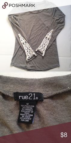 Grey embellished longsleeve shirt Grey longsleeved shirt with lace embellishments on the bottom of the sleeves. Never worn but great for any time of the year! Rue 21 Tops Tees - Long Sleeve