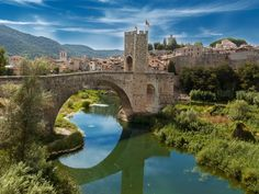 The people of Catalonia are famously proud of their history. And when you walk down Besalú's cobbled streets or cross the 12th-century bridge that straddles the Fluvià river, it can feel like you're back in a time when this charming village of just 2,500 people was the capital of an entire Medieval county.